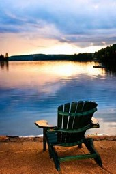 Wooden Chair by the Lake at Sunset