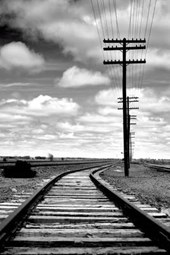 Train Tracks and Power Lines in Black and White