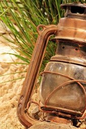 An Antique Rusted Lantern Left at the Beach