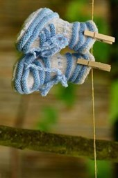 Newborn Blue Baby Shoes on a Clothesline