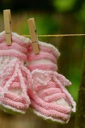 Newborn Pink Baby Shoes on a Clothesline