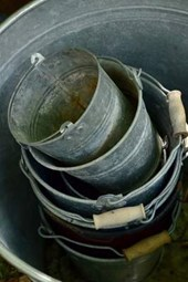 A Large Stack of Empty Steel Pots