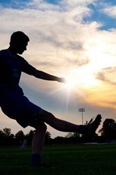 A Soccer Player at Sunset
