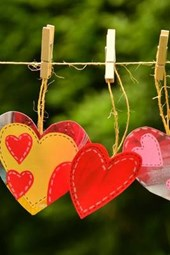 Three Paper Hearts on a Clothesline