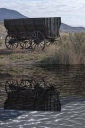 An Old West Wagon Reflected on the Pond