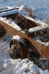 An Old Rusted Mine Cart Covered in Snow | Unique Journal |
