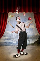 A Mime Juggling at the Carnival
