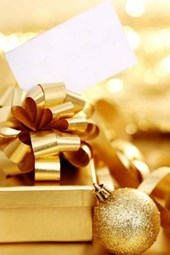 A Christmas Gift Wrapped in Gold with Gold Ornaments