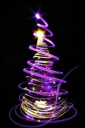 A Christmas Tree Surrounded in Purple Light