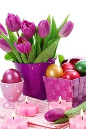 A Basket of Easter Eggs and a Vase of Purple Tulips