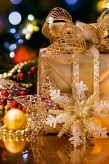 A Gold Paper Wrapped Present in Front of the Christmas Tree | Unique Journal |