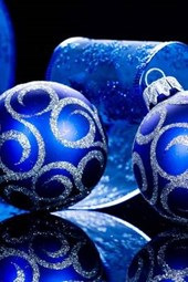 A Pair of Blue Christmas Ornaments Ready for the Tree