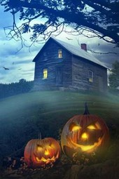 A Haunted House and a Pair of Lit Pumpkins
