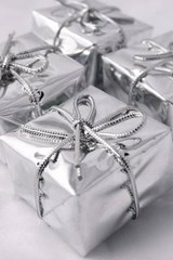 Christmas Presents Wrapped in Silver Paper and Ribbon | Unique Journal |