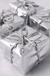 Christmas Presents Wrapped in Silver Paper and Ribbon
