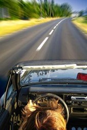 Driving on a Country Road in a Convertible