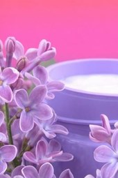 Spa Face Cream and Lilac Flowers