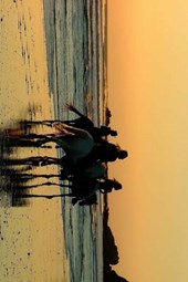 Riding Horses at Sunset on the Oregon Coast