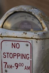 An Old White Parking Meter