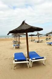 Sun Loungers and Parasols on Victoria Beach in Cadiz Spain Journal