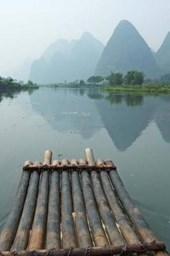 A Bamboo Raft and Mountain View in Guangxi China Journal