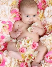 Jumbo Oversized Cute Baby in a Bed of Flowers