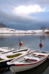 A Dusting of Snow on Fishing Boats in Finland Journal