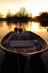 A Sunkissed Boat on a Golden Pond at Sunset Lined Journal
