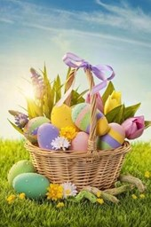 Basket Filled With Colorful Easter Eggs on the Grass Journal