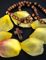 Jumbo Oversized Rosary Beads Surrounded by Rose Petals | Unique Journal |