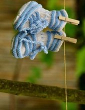 Jumbo Oversized Newborn Blue Baby Shoes on a Clothesline