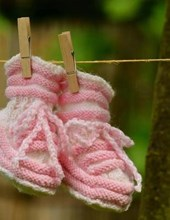 Jumbo Oversized Newborn Pink Baby Shoes on a Clothesline