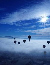 Jumbo Oversized Hot Air Ballons Flying Above the Clouds