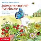 Schmetterling trifft Pusteblume.