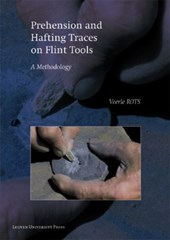 Prehension and Hafting Traces on Flint Tools